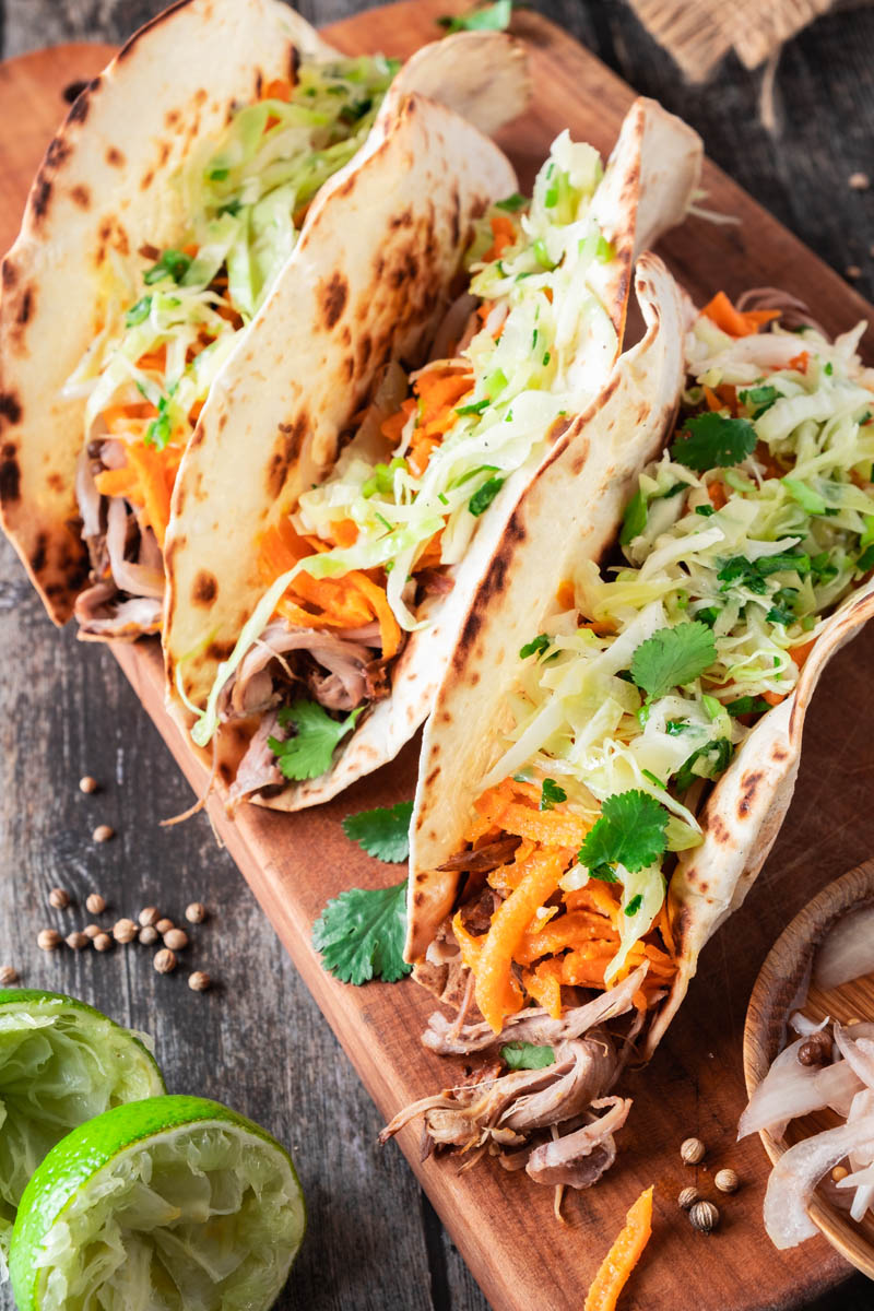 finished lamb tacos on cutting board