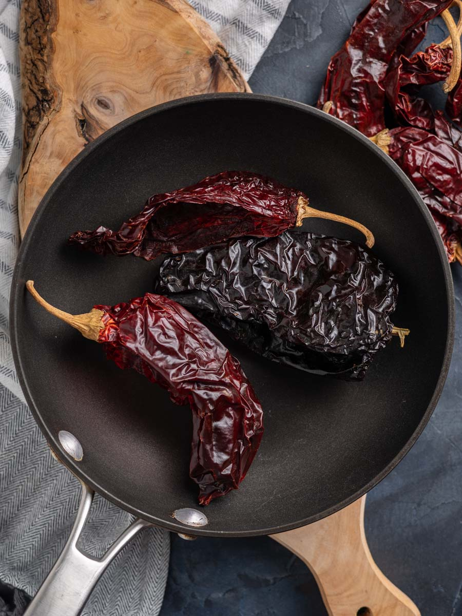 dried chiles toasted in a saute pan