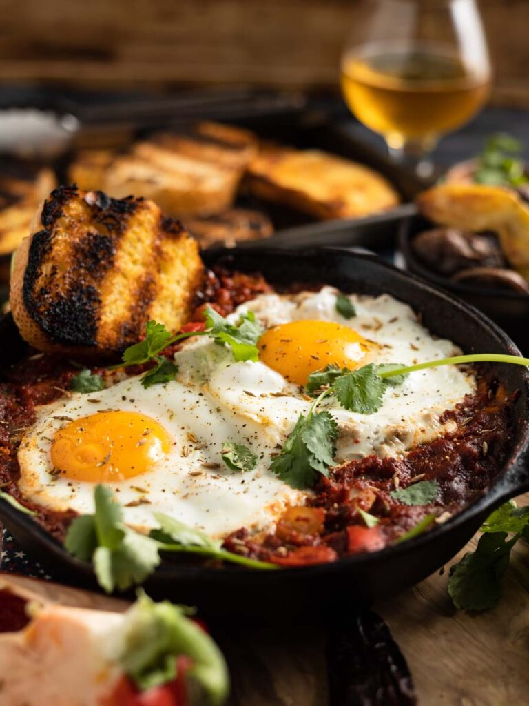 mexican baked eggs in a castiron pan