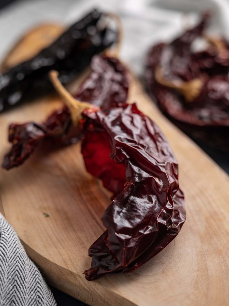 dried chiles on a cutting board