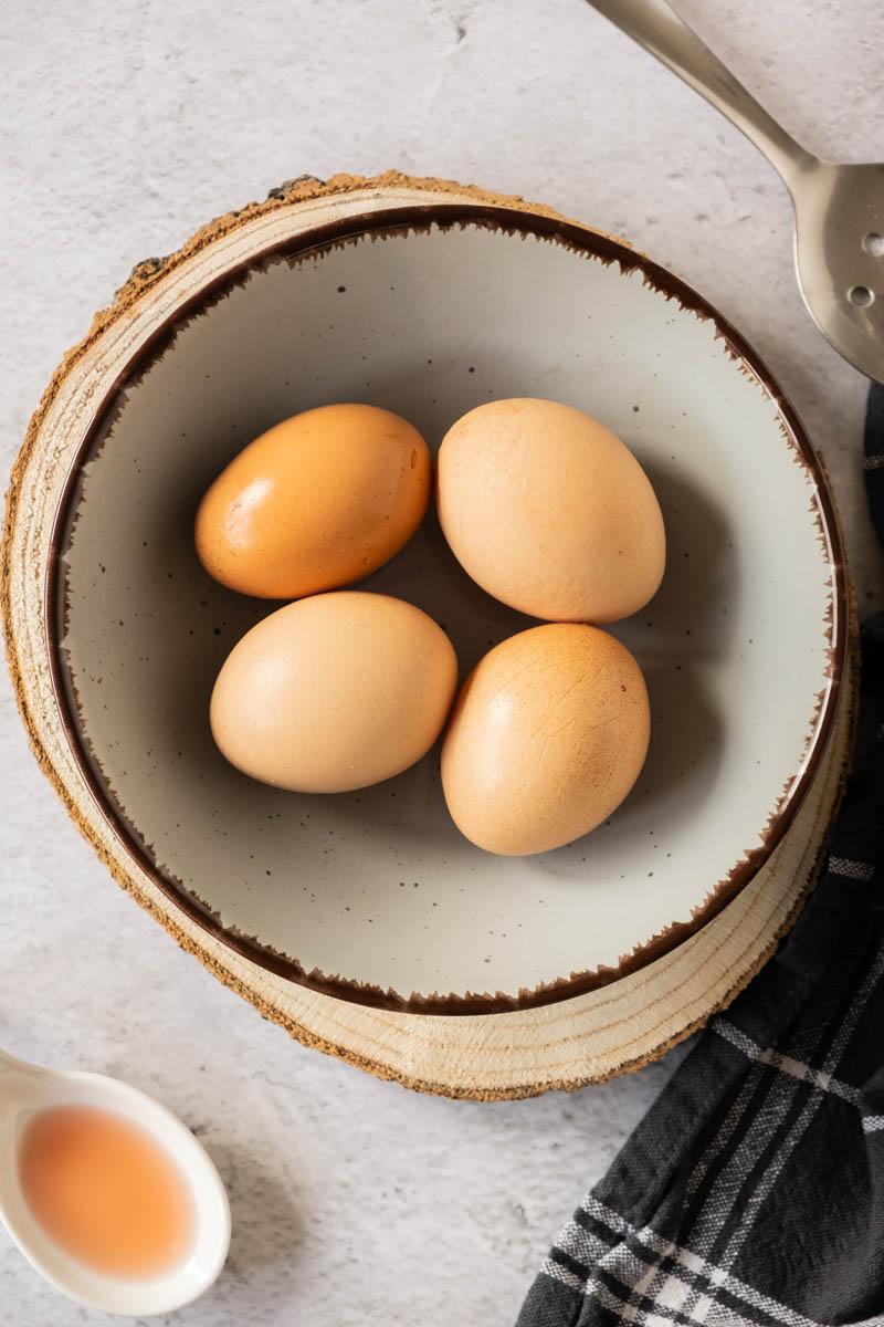 Fresh eggs in bowl.