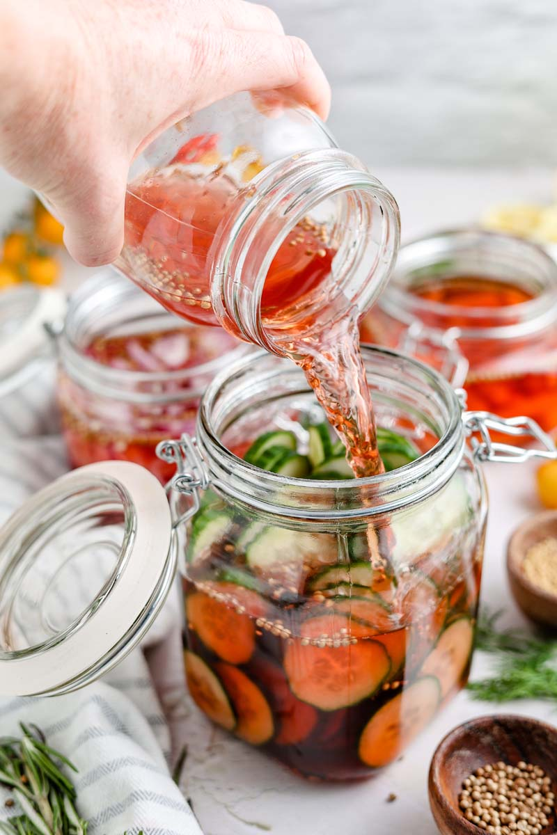 pickled cucumbers in a jar