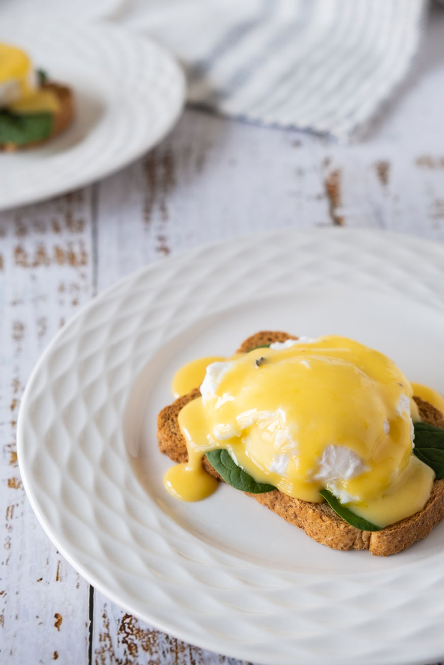 Poached egg on toast with hollandaise sauce.