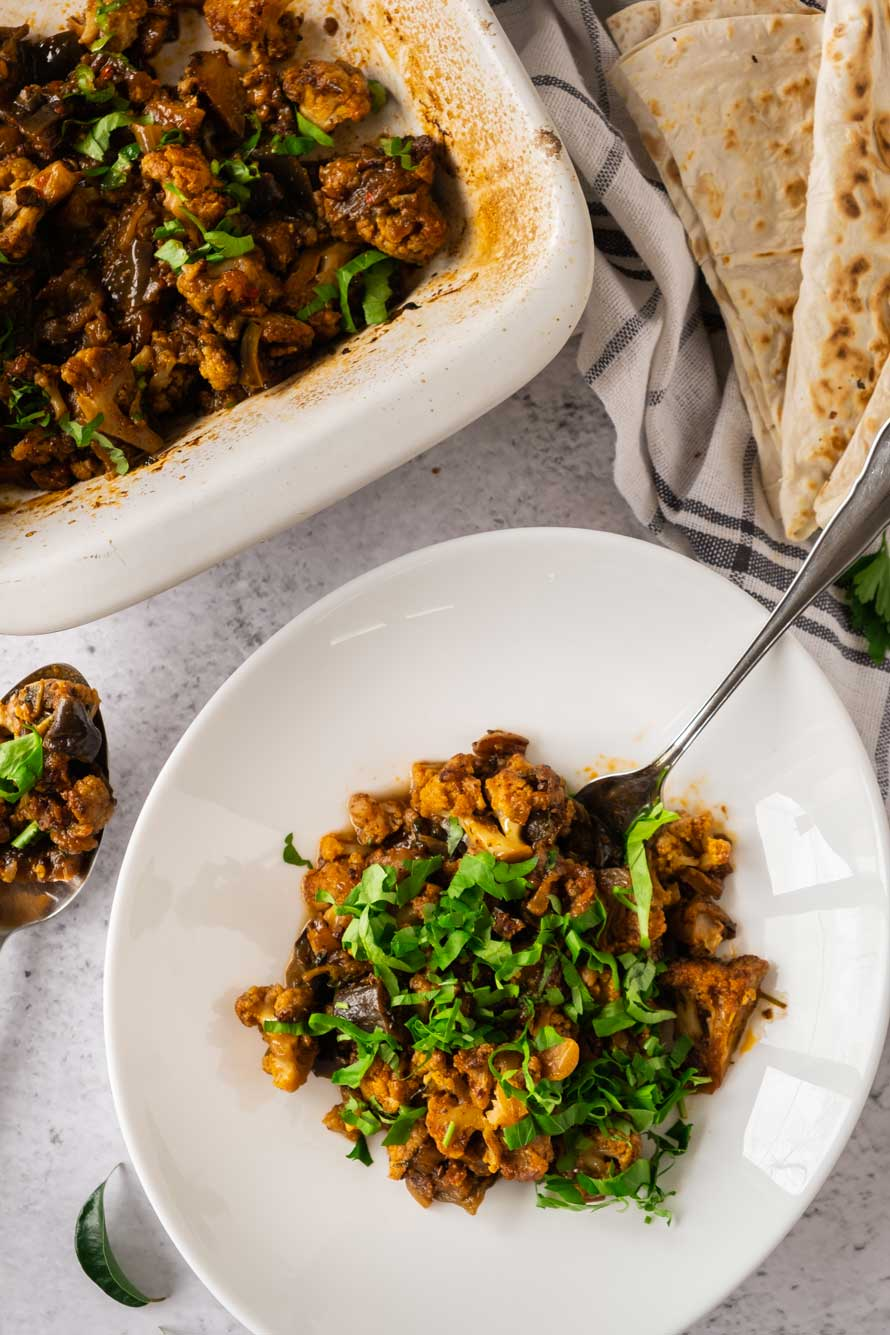 Vadouvan cauliflower and eggplant in bowl and casserole.