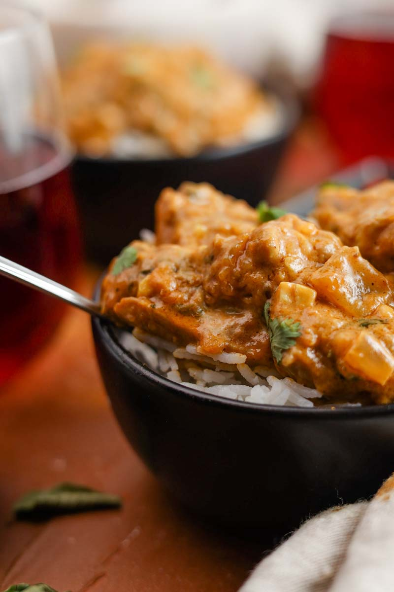 vadouvan curry chicken and cardamom rice in a bowl