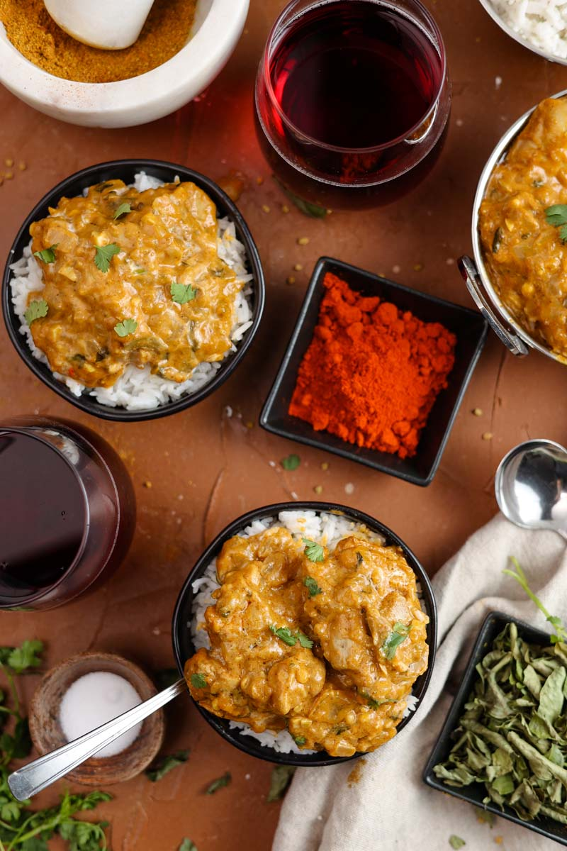 vadouvan curry chicken and cardamom rice in bowls
