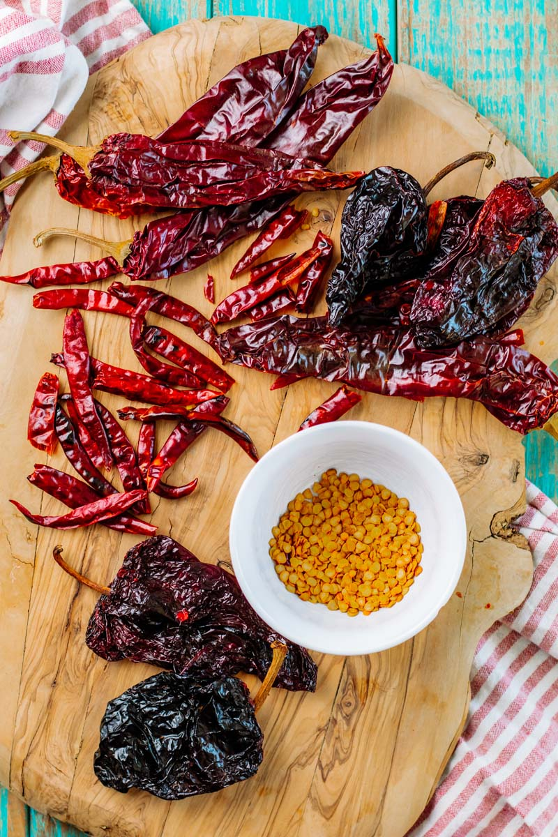 Dried chiles on a cutting board.