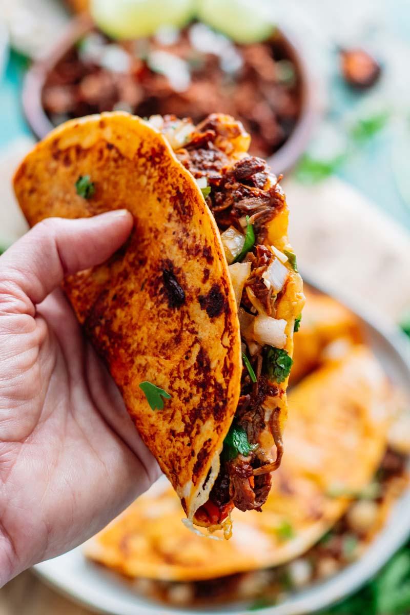 Birria taco in hand.