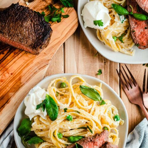 ricotta basil fettuccine and steak on plate