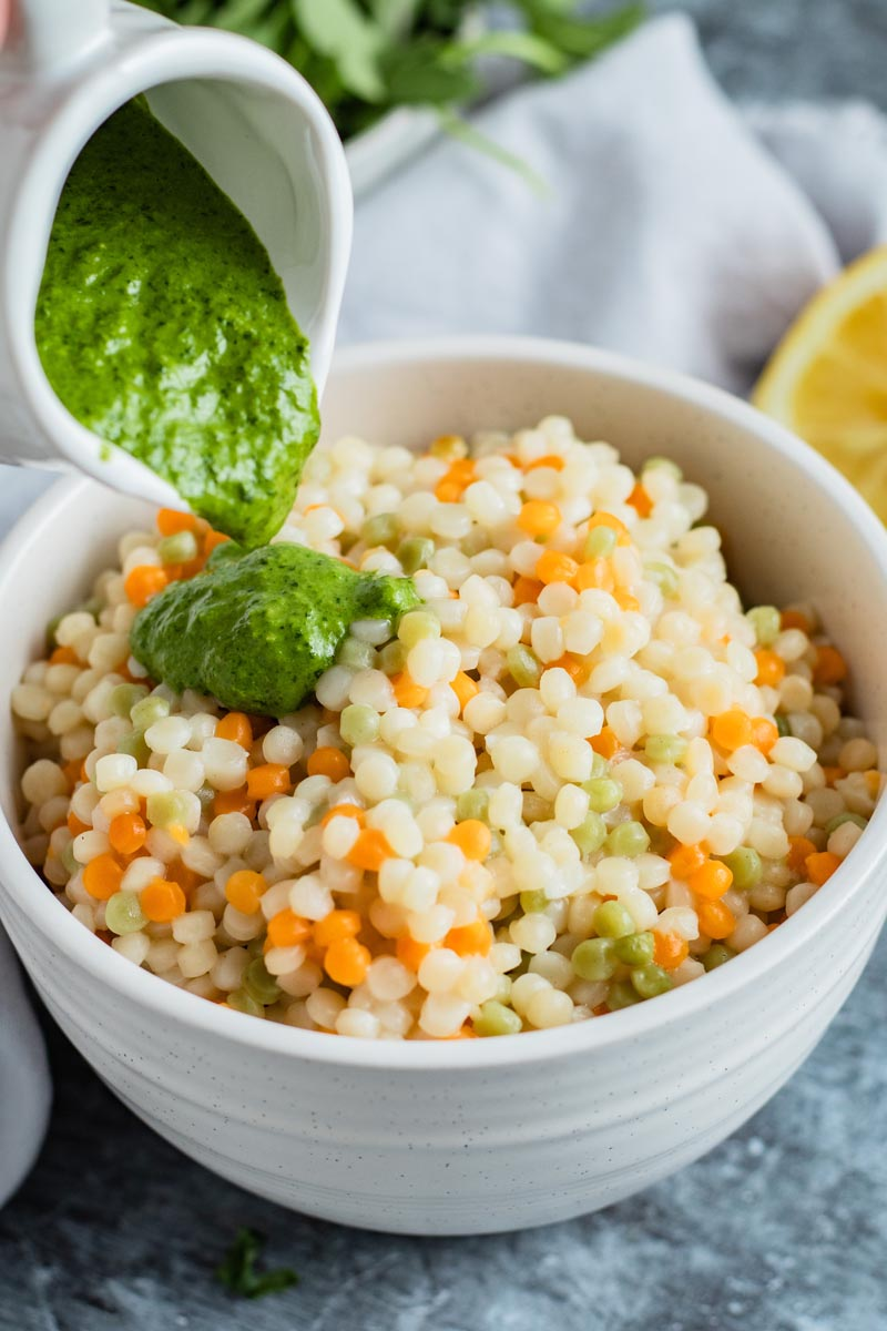 zhoug sauce over couscous in bowl