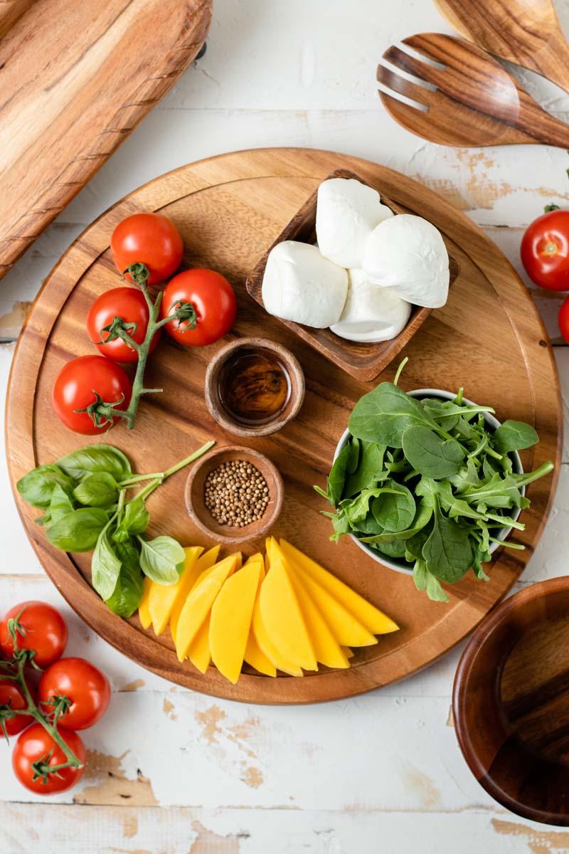 burrata salad ingredients on platter