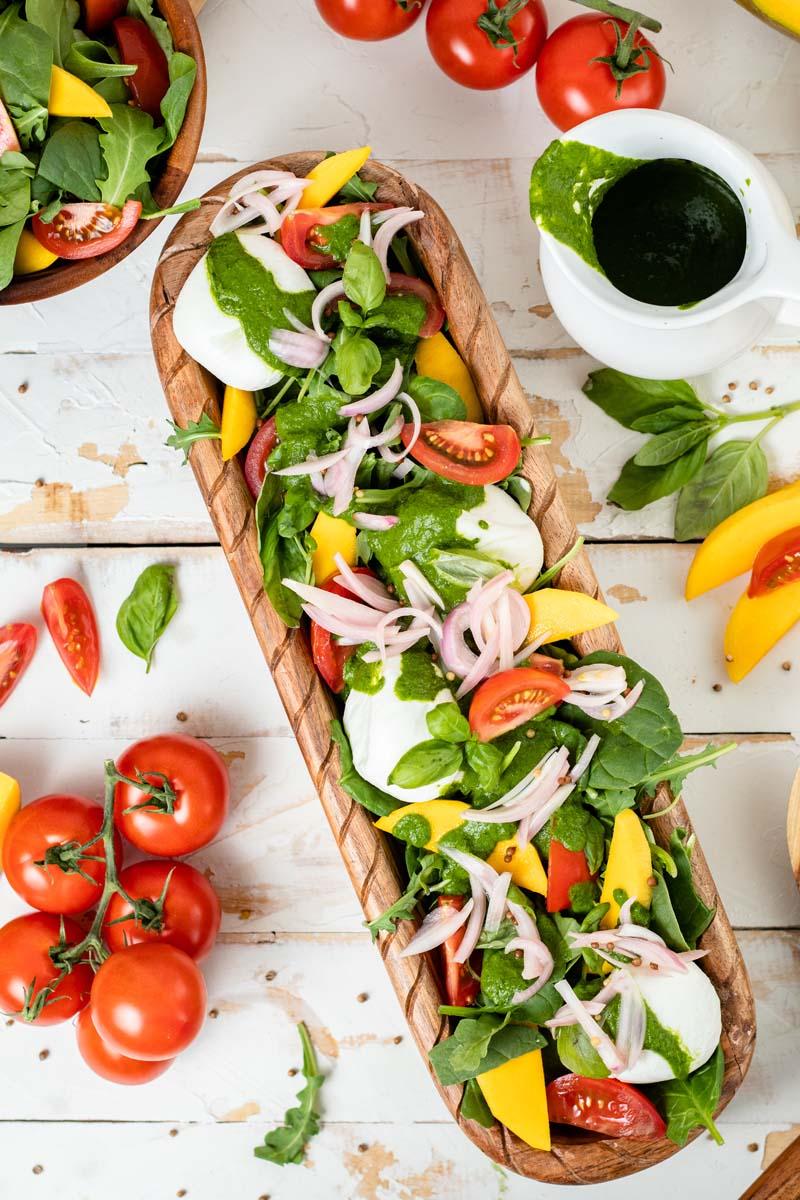 burrata salad on platter with basil vinaigrette