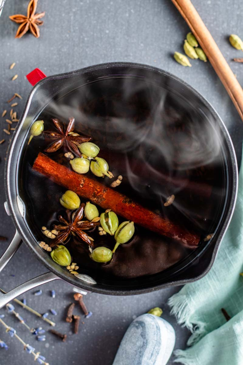chai spices boiling in pot