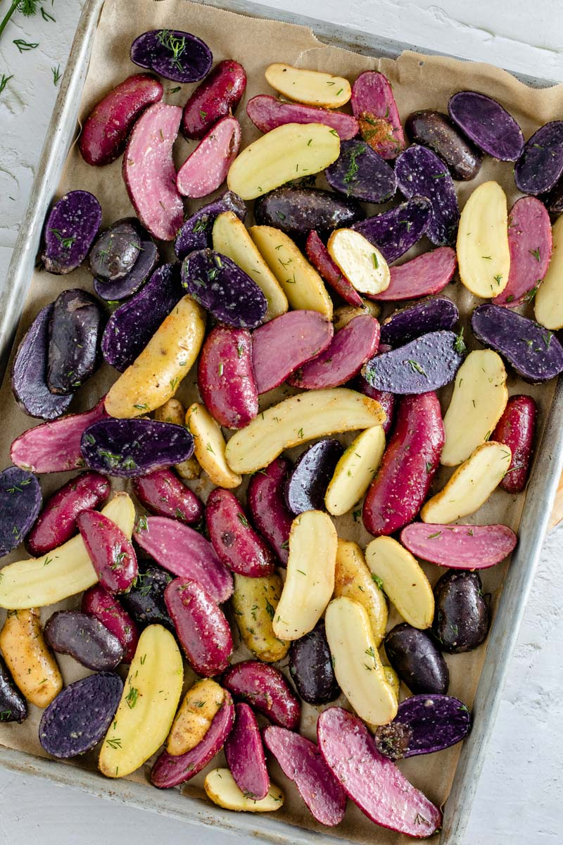 roasted fingerling potatoes on baking sheet before cooking