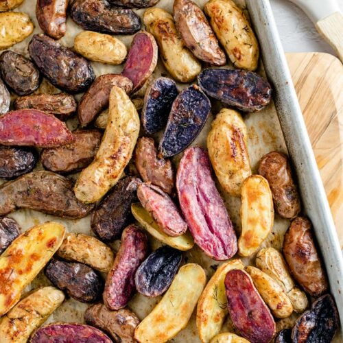 roasted fingerling potatoes on baking sheet