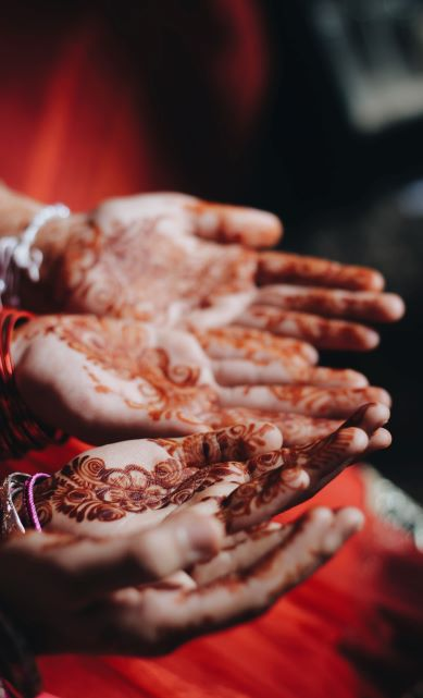 Hands with mehndi designs.