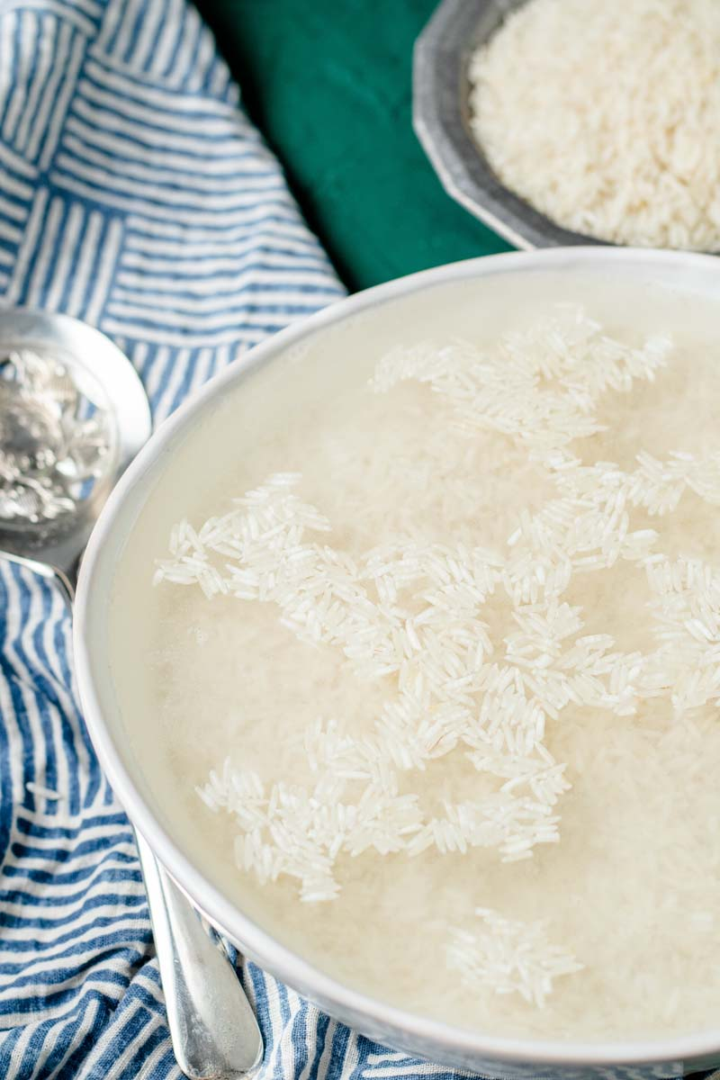 rice soaking in a bowl in water