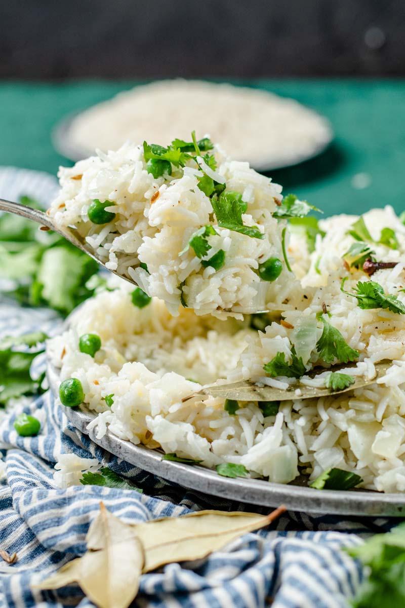 spooning jeera rice