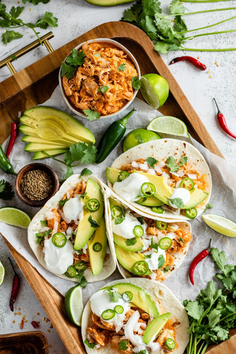 tinga de pollo tacos on a platter