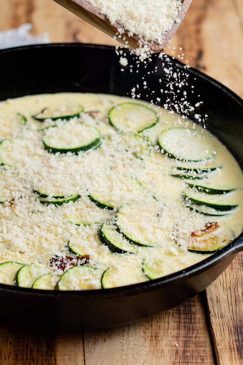 zucchini gratin in cast iron before cooking