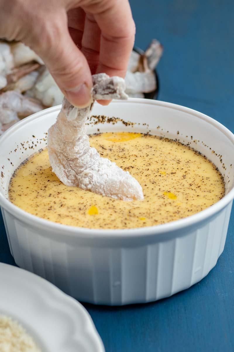 dipping shrimp in egg wash
