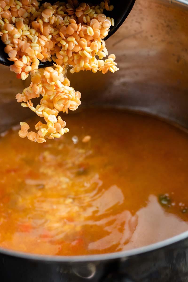 adding lentils to pot
