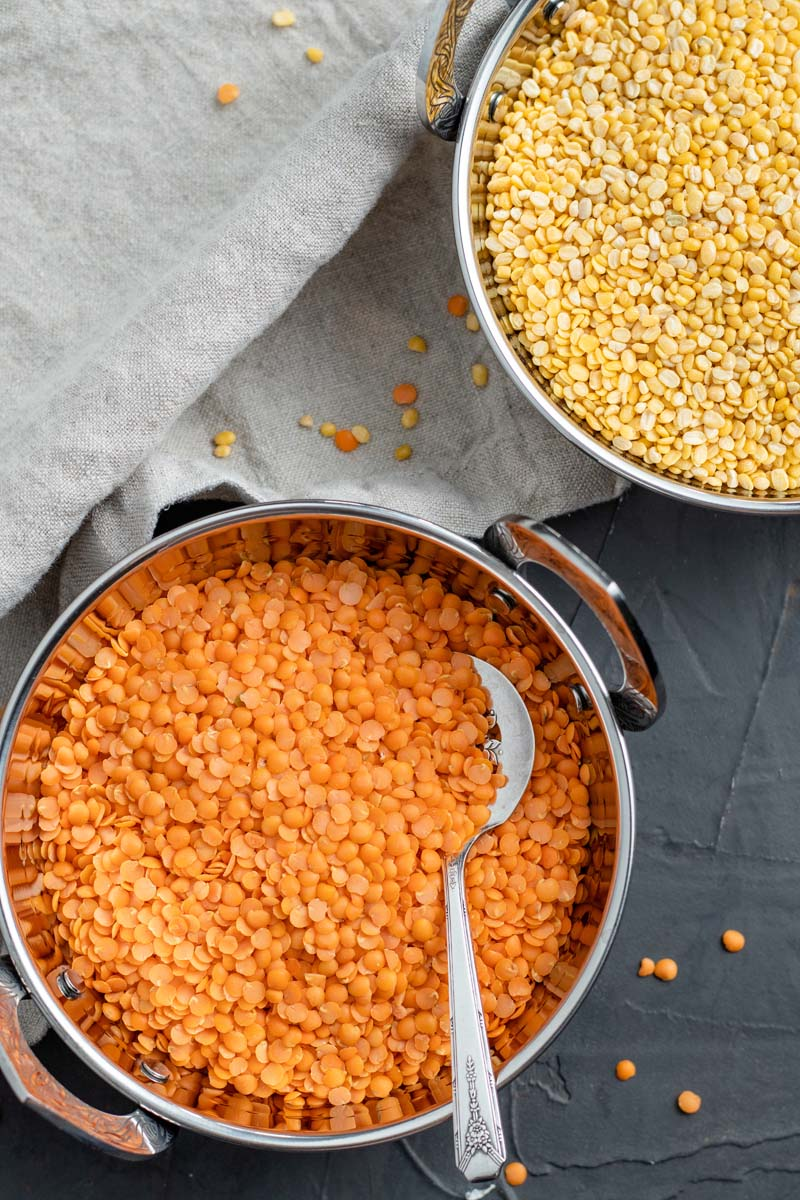 yellow and red lentils in bowls