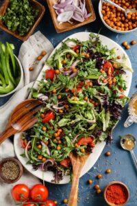 chickpea and arugula salad on a platter