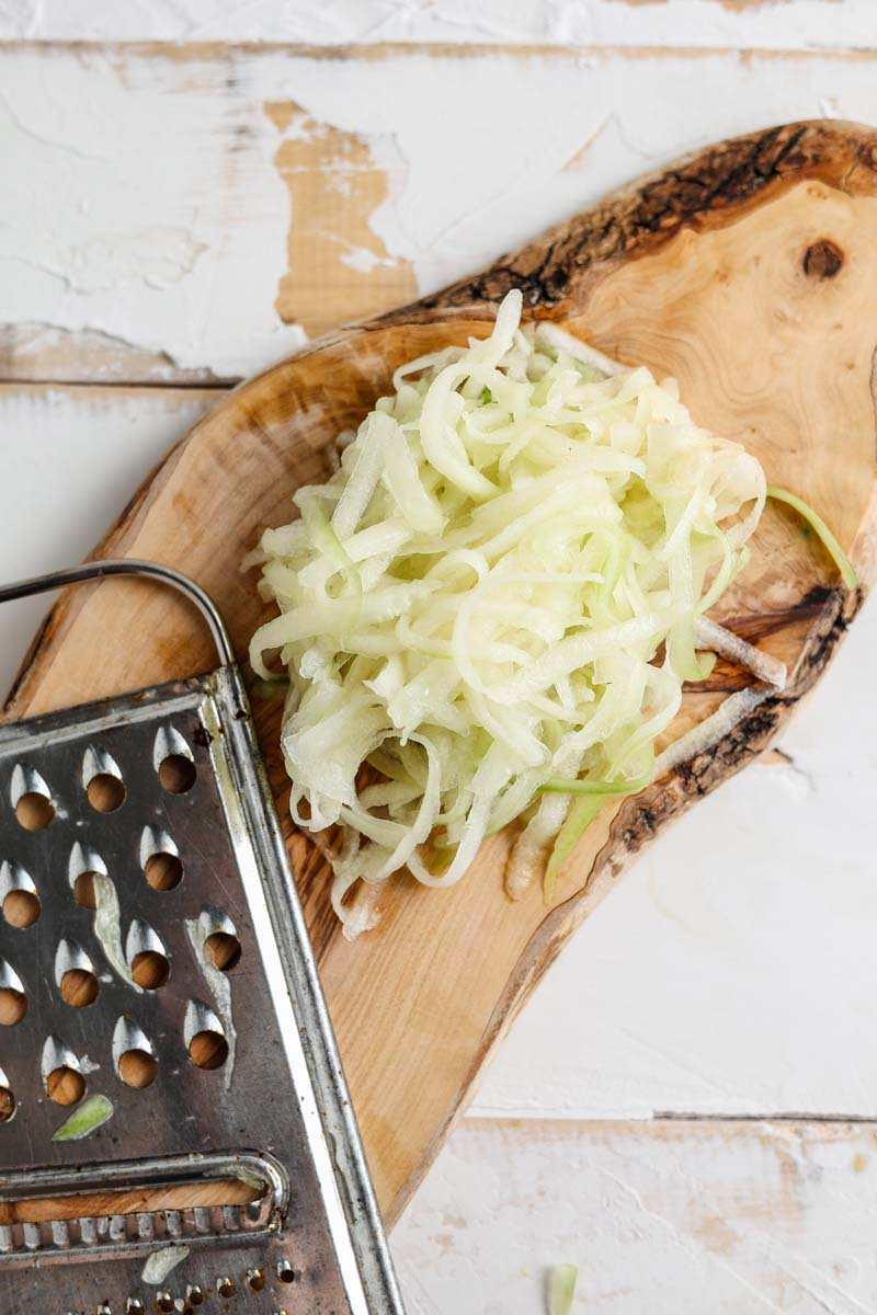 grated cucumber on a cutting board