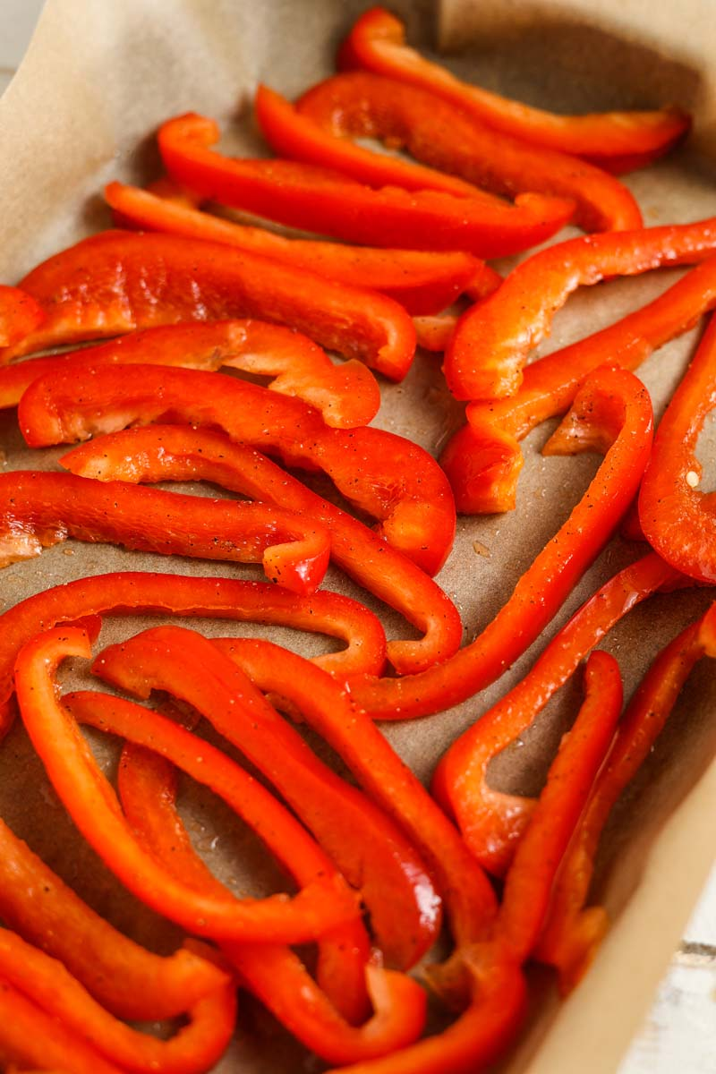 roasted red peppers on a baking sheet before baking