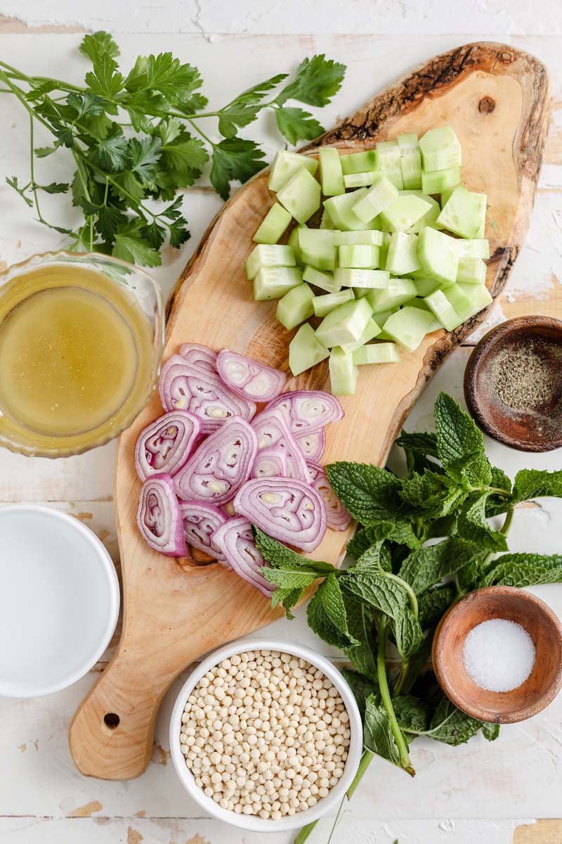 tabbouleh salad ingredients on a cutting board