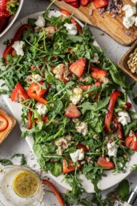 strawberry and spinach salad on a platter